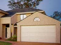 Grange Sectional Garage Door By Pirie Enterprises Gold